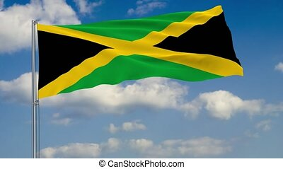 Flag of Jamaica against background of clouds sky - Flag of...