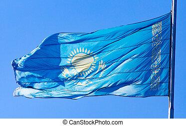 Flag of Kazakhstan against the blue sky