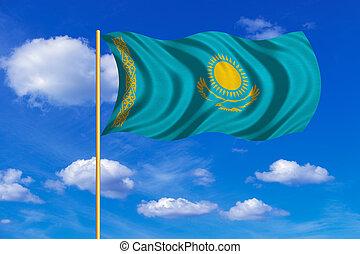 Flag of Kazakhstan waving on blue sky background