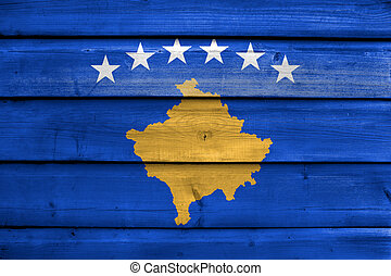 Flag of Kosovo, painted on old wood plank background