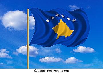 Flag of Kosovo waving on blue sky background