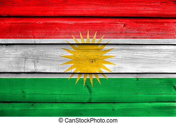 Flag of Kurdistan, painted on old wood plank background