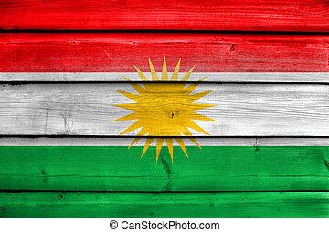Flag of Kurdistan, painted on old wood plank background