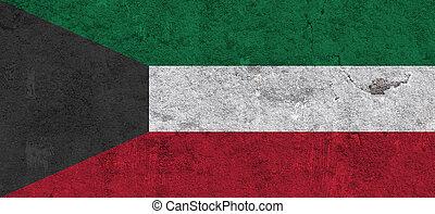 Flag of Kuwait on weathered concrete