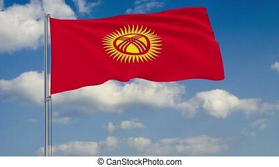 Flag of Kyrgyzstan against background of clouds
