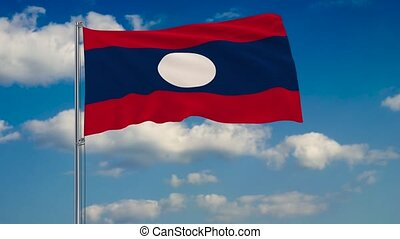 Flag of Laos against background of clouds floating on the blue sky