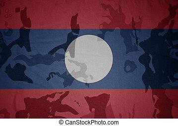 flag of laos on the khaki texture . military concept