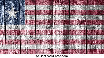 Flag of Liberia on weathered wood