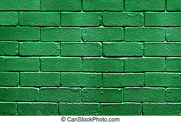 Flag of Libya painted onto a grunge brick wall
