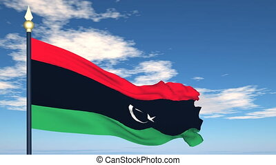Flag Of Libya on the background of the sky and flying...