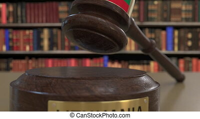 Flag of Lithuania on falling judges gavel in court. National...