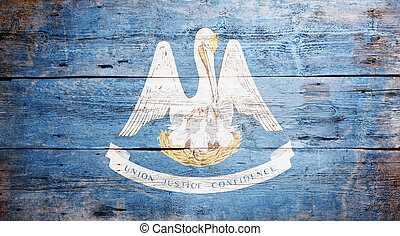 Flag of Louisiana painted on grungy wooden background
