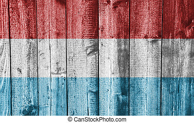 Flag of Luxembourg on weathered wood