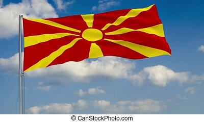Flag of Macedonia against background of clouds sky