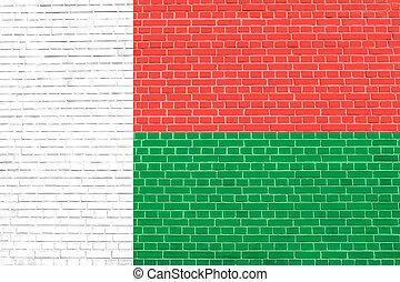 Flag of Madagascar, brick wall texture background