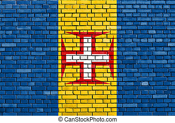 flag of Madeira painted on brick wall