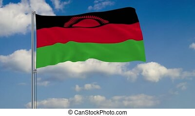 Flag of Malawi against background of clouds