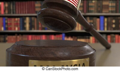 Flag of Malaysia on falling judges gavel in court. National...