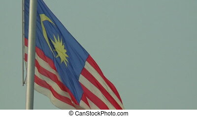 Flag of Malaysia on Flagpole - Steady, close up shot of the...