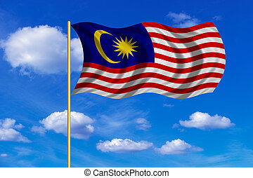 Flag of Malaysia waving on blue sky background