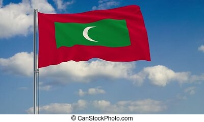 Flag of Maldives against background of clouds