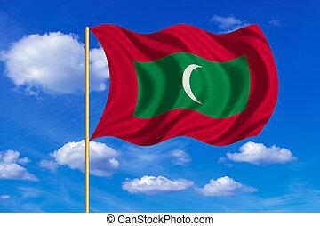 Flag of Maldives waving on blue sky background