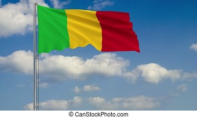 Flag of Mali against background of clouds sky