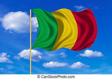 Flag of Mali waving on blue sky background