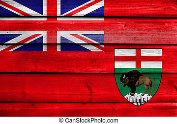Flag of Manitoba Province, Canada, painted on old wood plank...