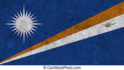 Flag of Marshall Islands on weathered concrete