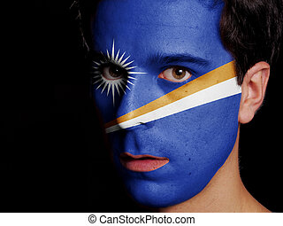 Flag of Marshall Islands Painted on a Face of a Young Man