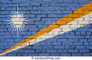 Flag of Marshall Islands painted on brick wall, background texture