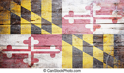 Flag of Maryland painted on grungy wooden background