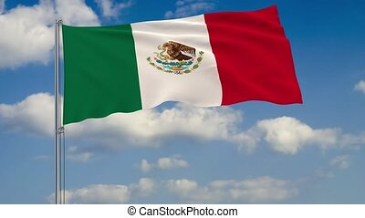 Flag of Mexico against background of clouds sky