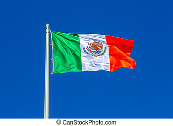 Flag of Mexico flying in the wind against the sky
