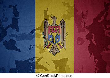 flag of moldova on the khaki texture . military concept