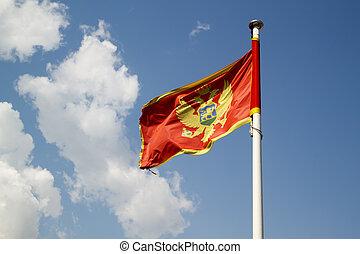 Flag of Montenegro against the blue sky
