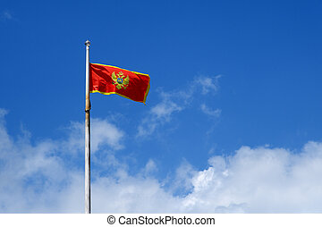 Flag of Montenegro on blue sky background