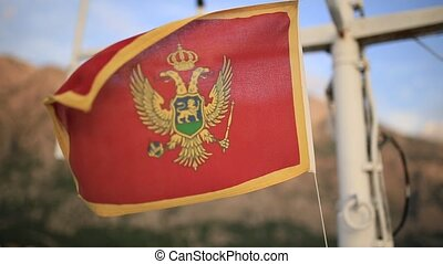 Flag of Montenegro, on the street, in the wind. Montenegro