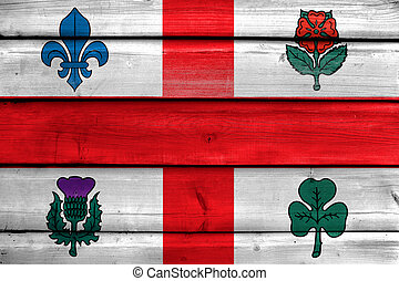 Flag of Montreal, Canada, painted on old wood plank background