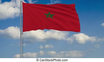 Flag of Morocco against background of clouds