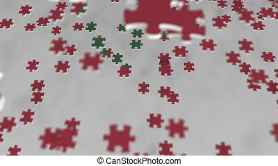 Flag of Morocco being made with jigsaw puzzle pieces....