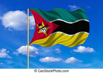Flag of Mozambique waving on blue sky background
