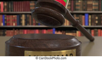 Flag of Myanmar on falling judges gavel in court. National...
