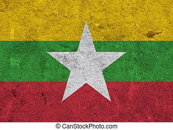 Flag of Myanmar on weathered concrete