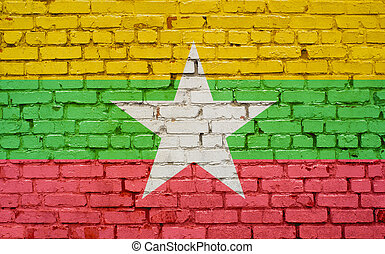 flag of Myanmar painted on brick wall