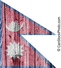 Flag of Nepal on weathered wood