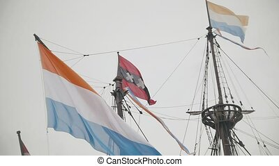 Flag of Netherlands and the symbol of Amsterdam - triple x...