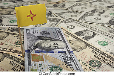 Flag of New Mexico sticking in various american banknotes.(series)