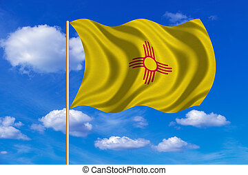 Flag of New Mexico waving on blue sky background